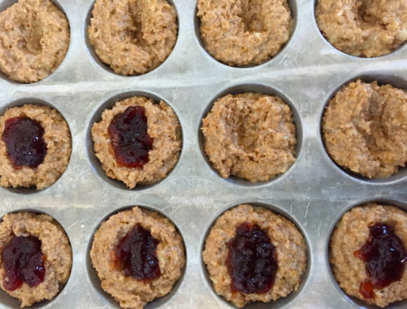 filling muffins with jam